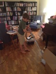 BigGuy learning to vacuum.  #fail  Now we sweep