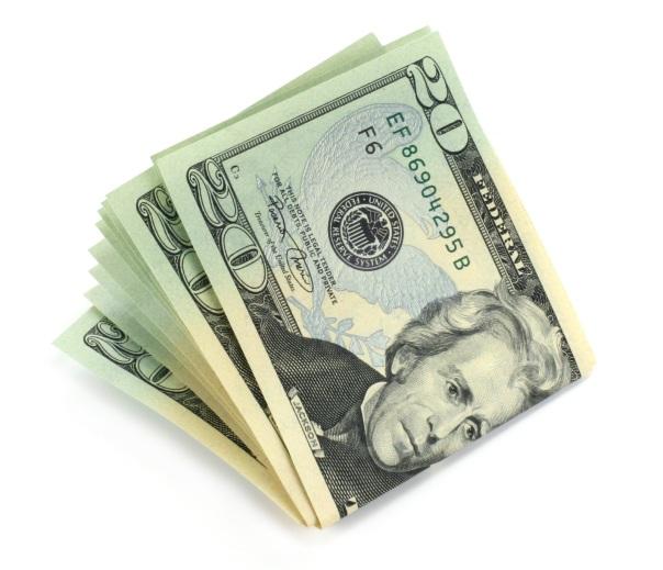 Twenty dollar bills isolated against white background.